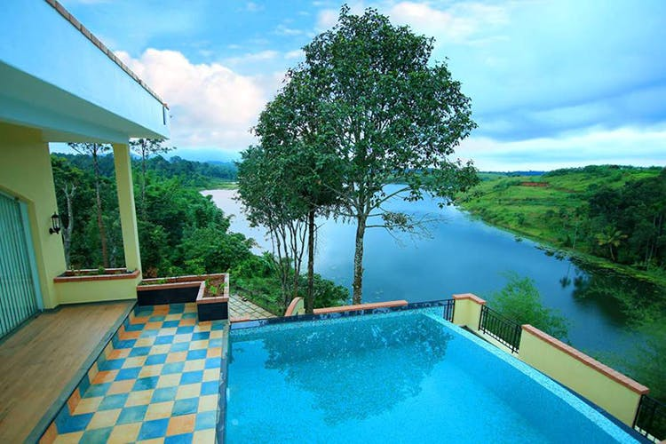 Property,Nature,Swimming pool,Natural landscape,Real estate,House,Resort,Building,Room,Tree