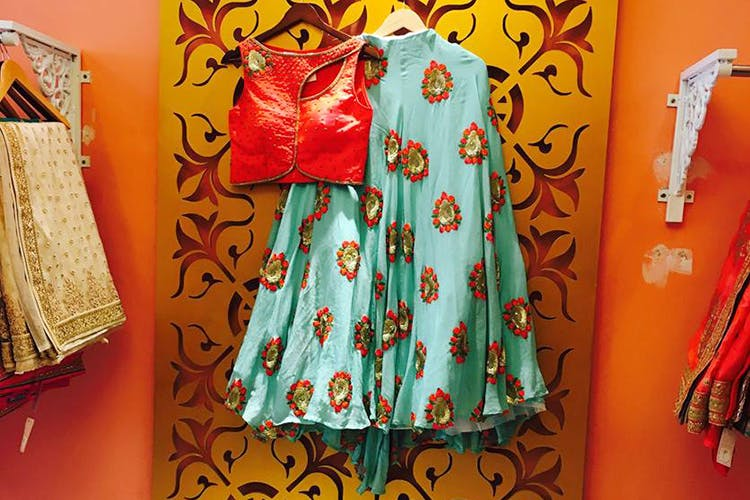 Clothing,Orange,Red,Dress,Yellow,Textile,Formal wear,Pattern,Peach,Embroidery