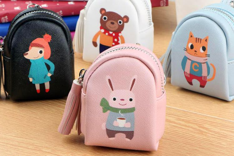 Cartoon,Coin purse,Pink,Backpack,Joint,Toy,Fashion accessory,Wallet,Zipper,Bag