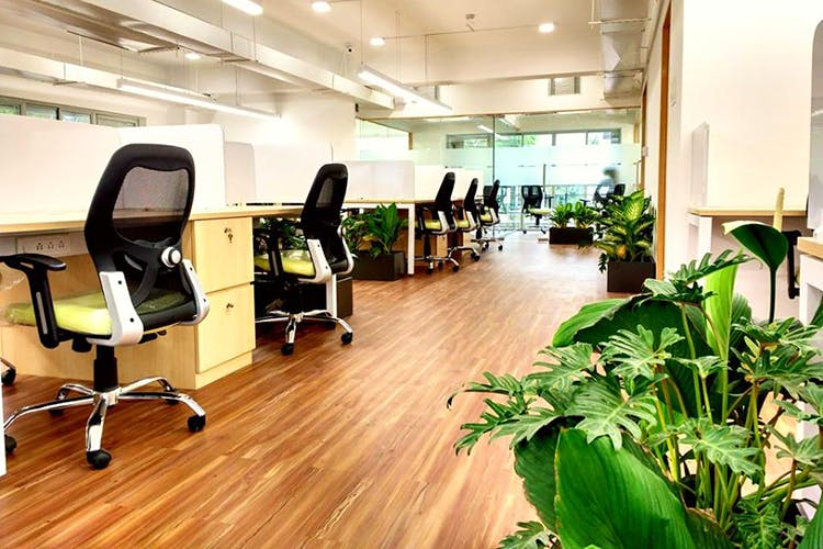 Floor,Flooring,Office,Building,Interior design,Room,Laminate flooring,Hardwood,Office chair,Wood flooring