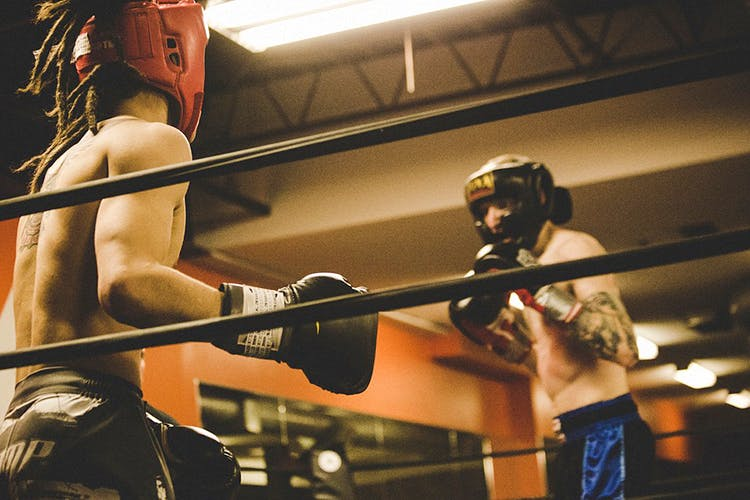 Combat sport,Sport venue,Wrestling,Boxing ring,Contact sport,Professional wrestling,Individual sports,Striking combat sports,Kickboxing,Professional boxer
