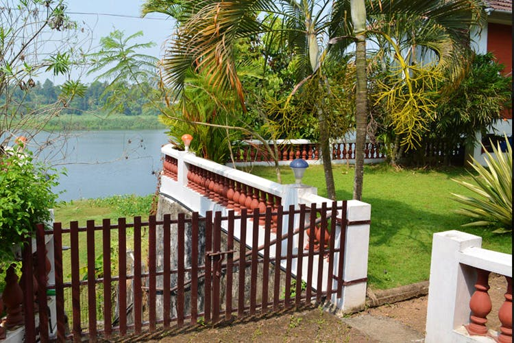 Property,Real estate,Home,House,Fence,Building,Tree,Backyard,Grass,Resort