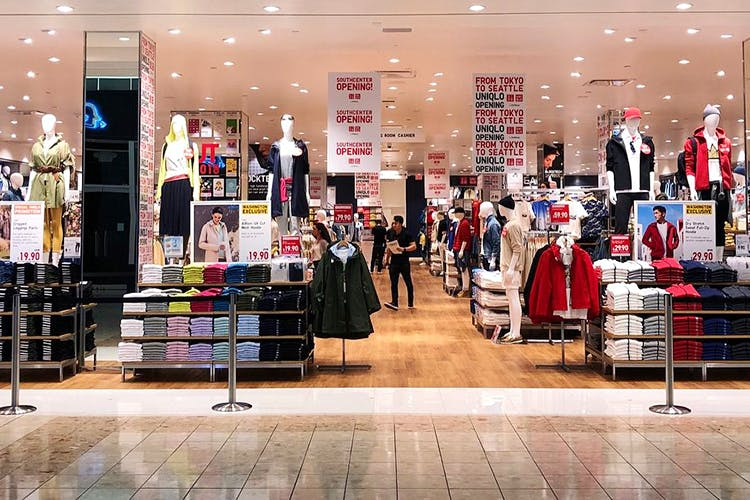 Outlet store,Boutique,Building,Retail,Shopping,Shopping mall,Event,Interior design,Display window