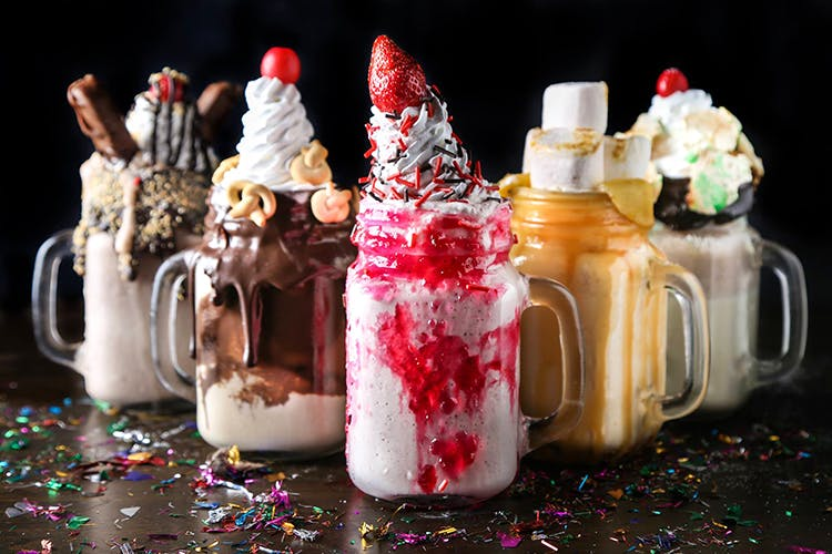 Food,Sundae,Dessert,Cream,Cuisine,Candy cane,Christmas,Whipped cream,Confectionery,Parfait