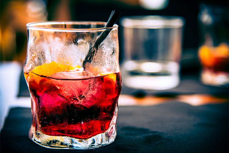 Drink,Campari,Alcoholic beverage,Distilled beverage,Negroni,Classic cocktail,Old fashioned glass,Woo woo,Spritz,Cocktail