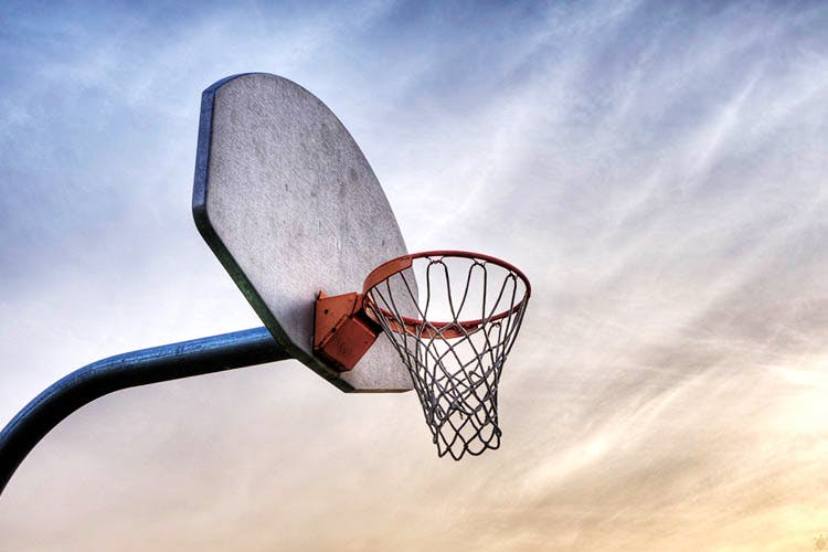 Basketball hoop,Basketball,Basketball court,Net,Sky,Basketball,Team sport,Streetball,Ball game,Cloud