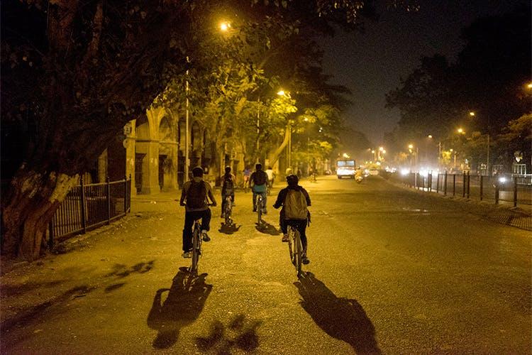 Night,Street light,Yellow,Light,Lighting,Tree,Sky,Street,Evening,Pedestrian