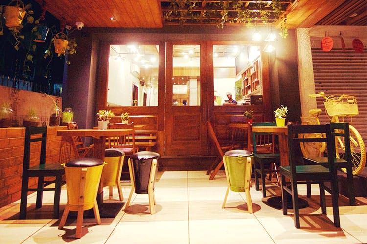 Room,Restaurant,Furniture,Table,Interior design,Building,House,Café,Wood,Home