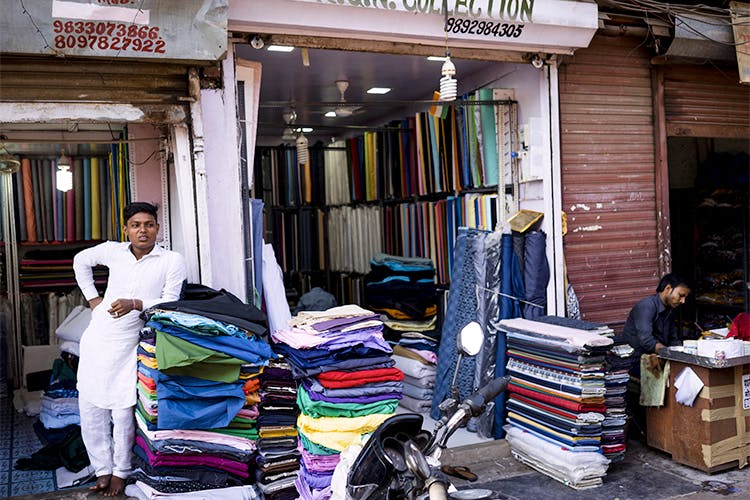 Selling,Public space,Street,Building,Textile,Market,Bazaar,Shopping,Retail,City