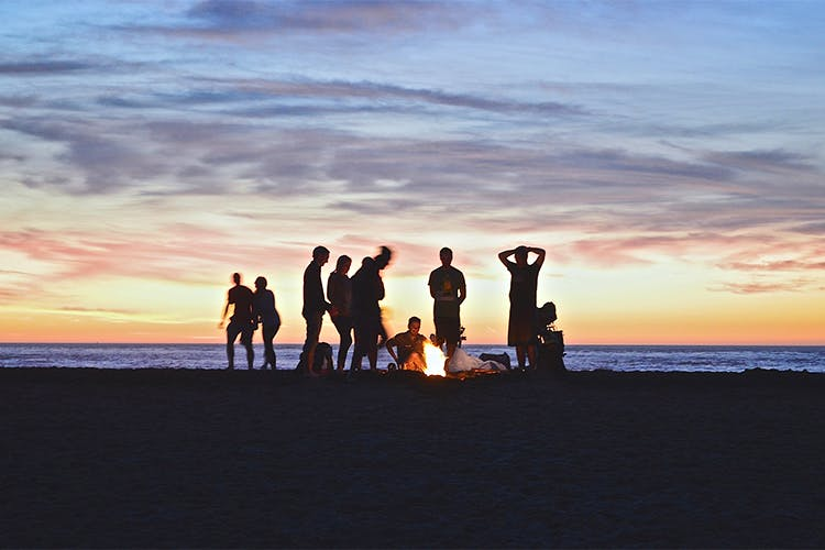 Sky,People on beach,Horizon,Sunset,Cloud,Ocean,Fun,Sea,Evening,Friendship