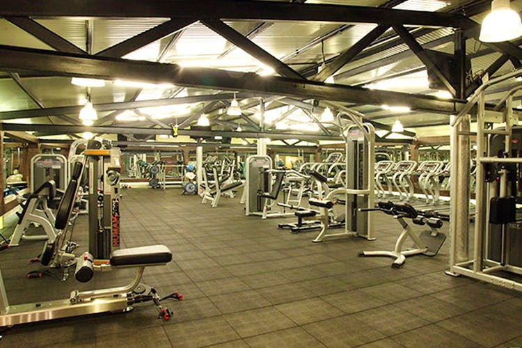 Gym,Sport venue,Room,Physical fitness,Exercise equipment,Exercise machine,Weight training,Arm,Exercise,Building