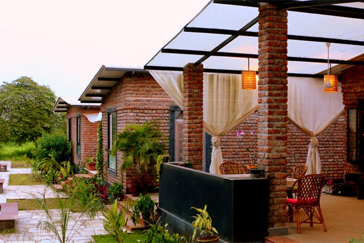 Property,House,Home,Roof,Building,Real estate,Backyard,Patio,Residential area,Pergola