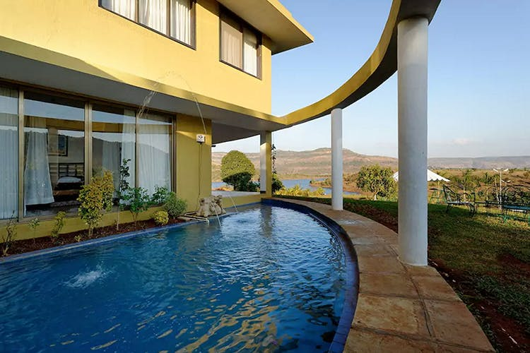Property,Swimming pool,House,Home,Building,Real estate,Estate,Residential area,Resort,Architecture