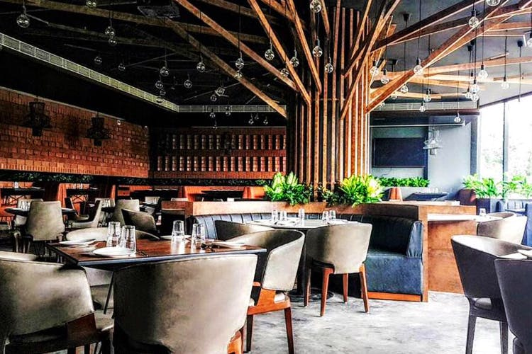 Restaurant,Property,Interior design,Building,Room,Furniture,Table,Architecture,House,Real estate