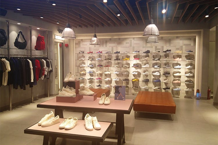 Shoe store,Building,Outlet store,Display case,Boutique,Retail,Footwear,Collection,Interior design,Eyewear
