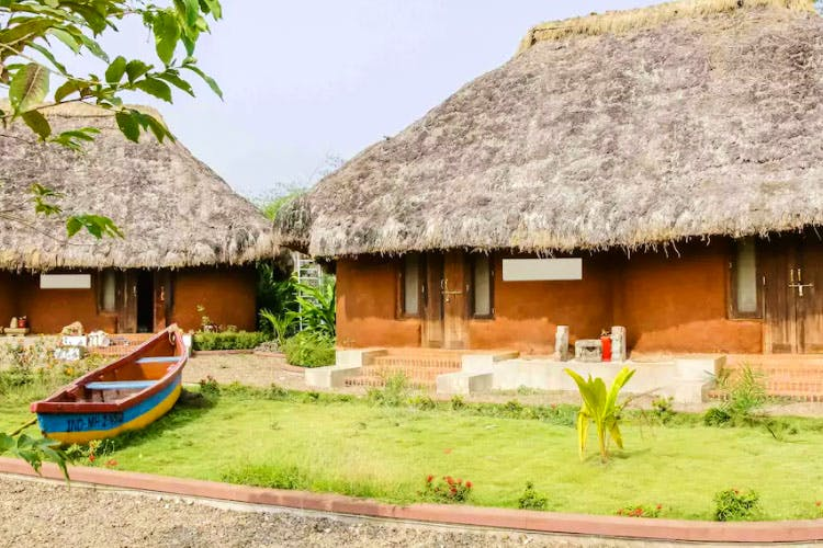 Thatching,Hut,Building,Village,Rural area,Roof,Cottage,Eco hotel,House,Landscape