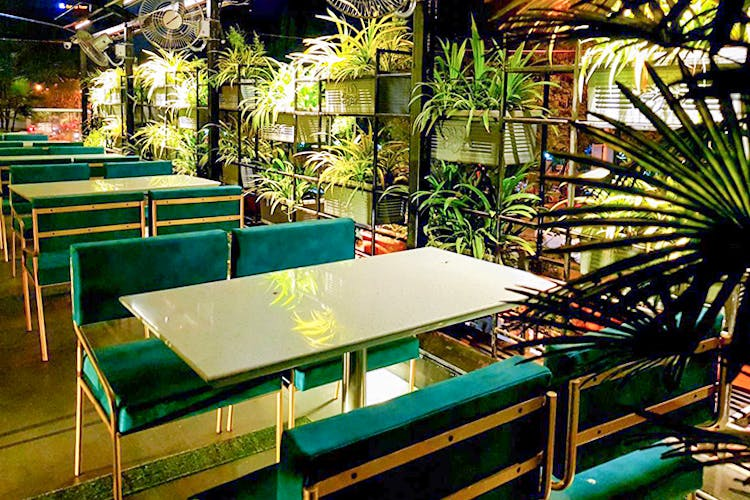 Green,Table,Furniture,Restaurant,Room,Building,Architecture,Leisure,Interior design,Plant