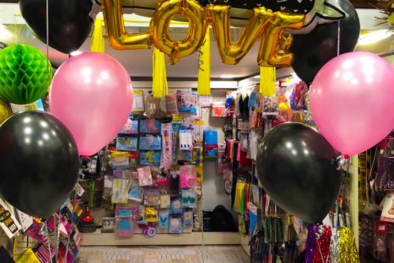 Balloon,Pink,Party supply,Toy,Fun,Architecture,Market,Event,Party,Magenta