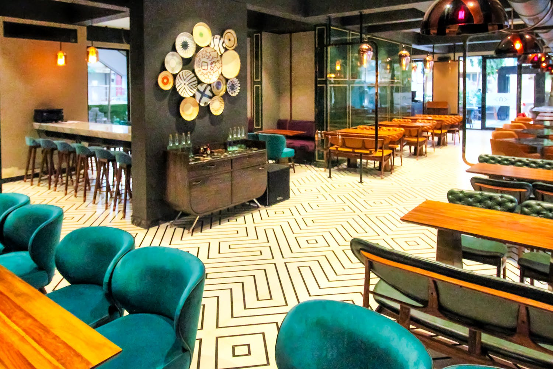 Interior design,Building,Room,Restaurant,Architecture,Bar,Furniture,Table,Leisure,Flooring